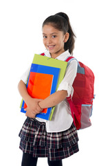cute little girl carrying school bag and books smiling