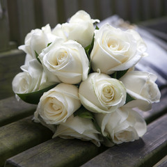 Wedding roses bouquet on wooden bench