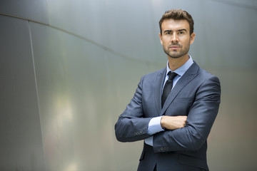 Portrait of confident businessman outside