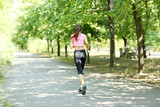 Fototapeta Young woman jogging at park