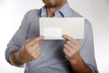 Man holds a letter into the camera