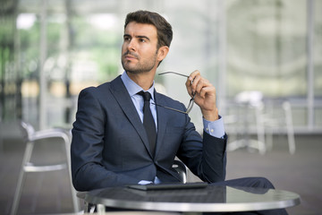 Isolated attractive business man listening