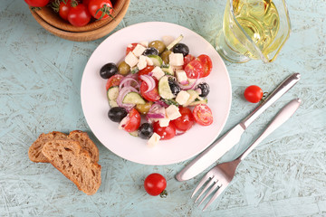 Greek salad in plate on wooden background