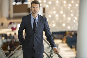 Portrait of attractive man in a mall