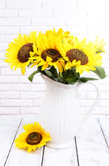 Beautiful bouquet of sunflowers in pitcher