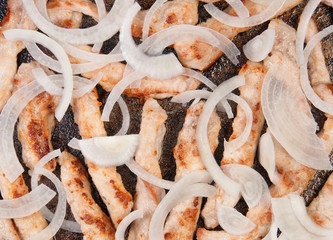 Meat Strips Fried With Onion In A Pan