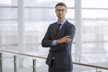 Portrait of a handsome young businessman wearing glasses