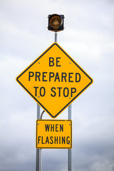 Be prepared to stop when flashing, road sign