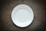 Empty  white plate on wooden background - 69909481