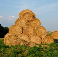 Yellow straw bale pyramid on a background of blue sky