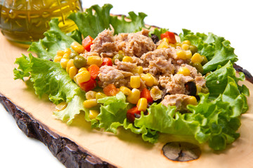 tuna salad with mais on wood board