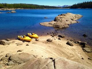 Kayaks resting on beautiful Lake shore.