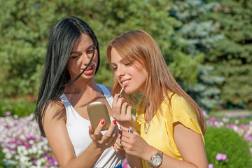 young Girls Applying Make up