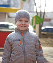 Smiling little toddler boy outdoors portrait