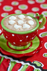 Red mugs with hot chocolate