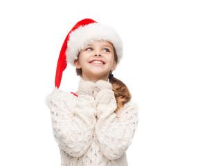 dreaming girl in santa helper hat