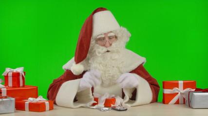 Santa Claus Getting a Call - Good News