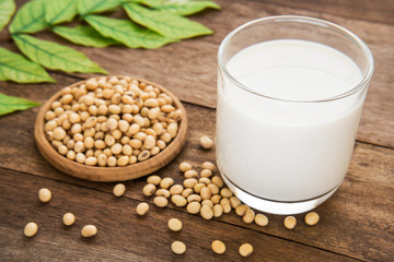 Soy milk and soy bean on wooden table