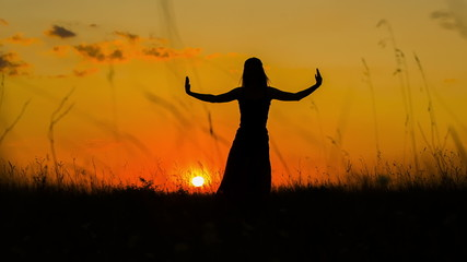 Silhouette of a Girl Doing Yoga  At Sunset