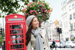 People in London - woman by red phone booth