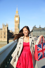 London woman tourist shopping bag near Big Ben