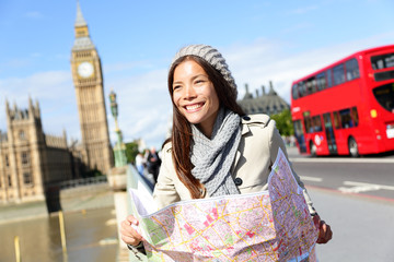 Travel London tourist woman holding map