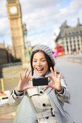 Travel tourist in london taking selfie photo