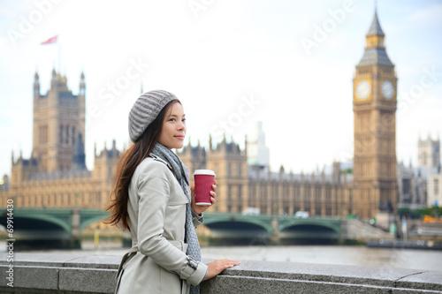 London woman drinking coffee by Westminster Bridge - 69914430