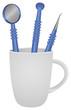 Mug with set dental instruments