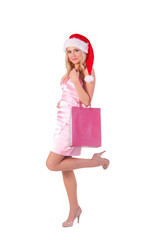 Woman in rose dress with santa hat
