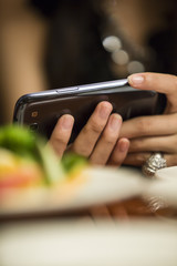 Women see the mobile phone during a meal