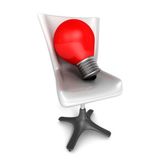 Idea concept with red light bulb and office chair
