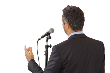 Rear view of a speaker speaking at the microphone