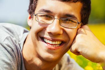 Smiling guy outdoors closeup