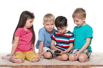 Four kids with a new gadget