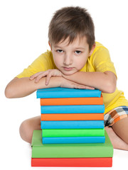 Clever little boy with books