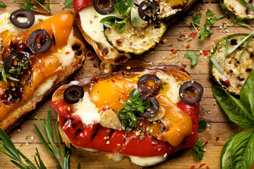 Bruschetta with grilled bell pepper, zucchini and  cheese