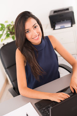 cheerful young woman office desk working with a laptop computer