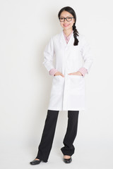 Asian Chinese girl in white lab uniform