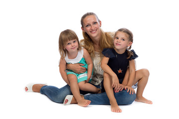 Family portrait of a young charming mother and two daughters.