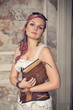 Beautiful steampunk woman with old book
