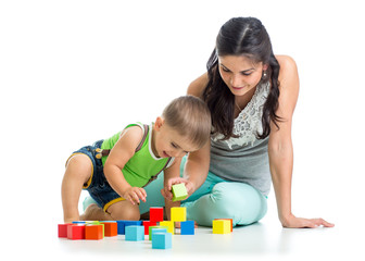 kid boy and mother playing together with block toys