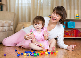 happy mother and kid play home
