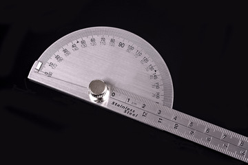 Protractor on black