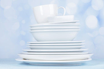 White crockery and kitchen utensils,