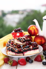 Sweet berry tart with berries on table on natural background