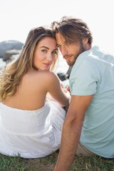 Gorgeous couple smiling at camera