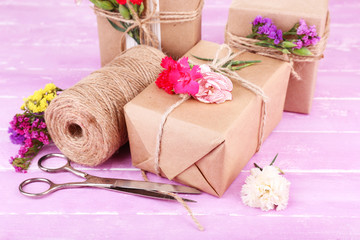 Beautiful gifts with flowers and decorative rope,
