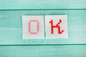 Word made embroidered letters