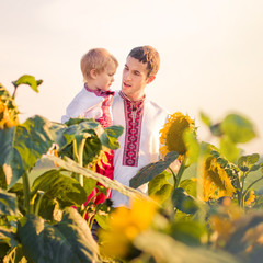 A father and young son in Ukrainian sunflower shirts considering